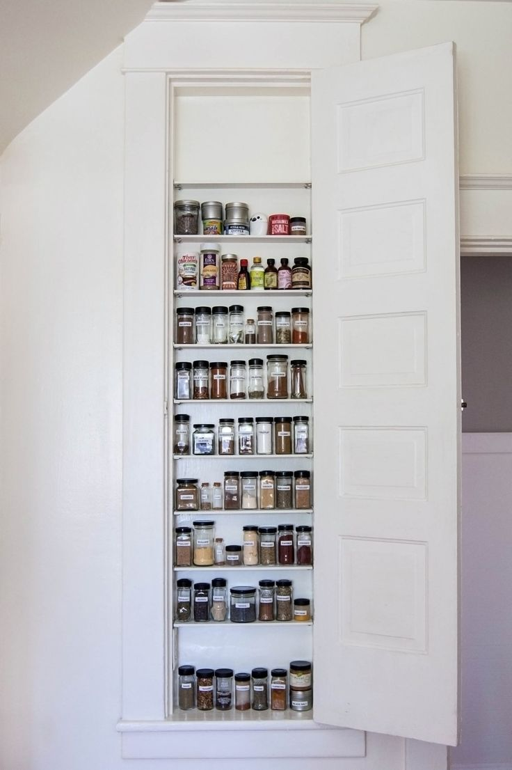 Formerly an ironing board cupboard in the kitchen becomes a spice cabinet - because who irons in the kitchen?