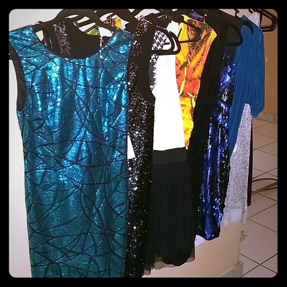 JUST LOWERD!! 10 Gorgeous Dresses size Small 10 gorgeous dresses size Small....9 nwt and 1 used once  Nwt Forever 21 aqua blue sequin dress Nwt Forever 21 black sequin on sides dress Nwt black and white bodycon Nwt black and white dress Nwt Yellow dress Nwt Boutique gliterry black dress  Nwt forever 21 black and blue dress Nwt forever 21 one sleeve blue dress Nwt silver beach dress  Black and gold slimfit dress Dresses