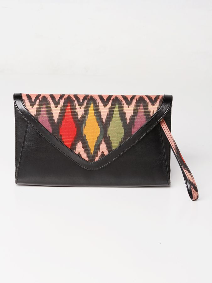 Chamomile Songket Clutch Bag #clutchbag #taspesta #handbag #fauxleather #kulit #tenun #songket #kombinasi #envelope #amplop #fashionable #simple #elegant #stylish #color #orange  Kindly visit our website : www.bagquire.com