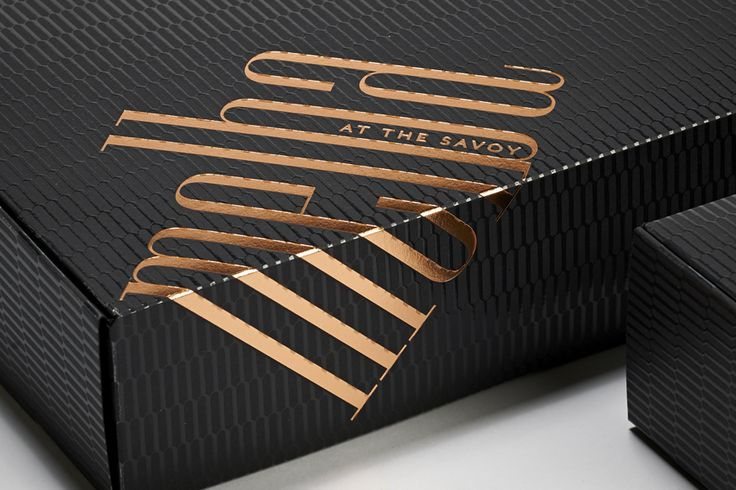 Logotype and copper foiled packaging designed by Pentagram for London patisserie and cafe Melba at The Savoy
