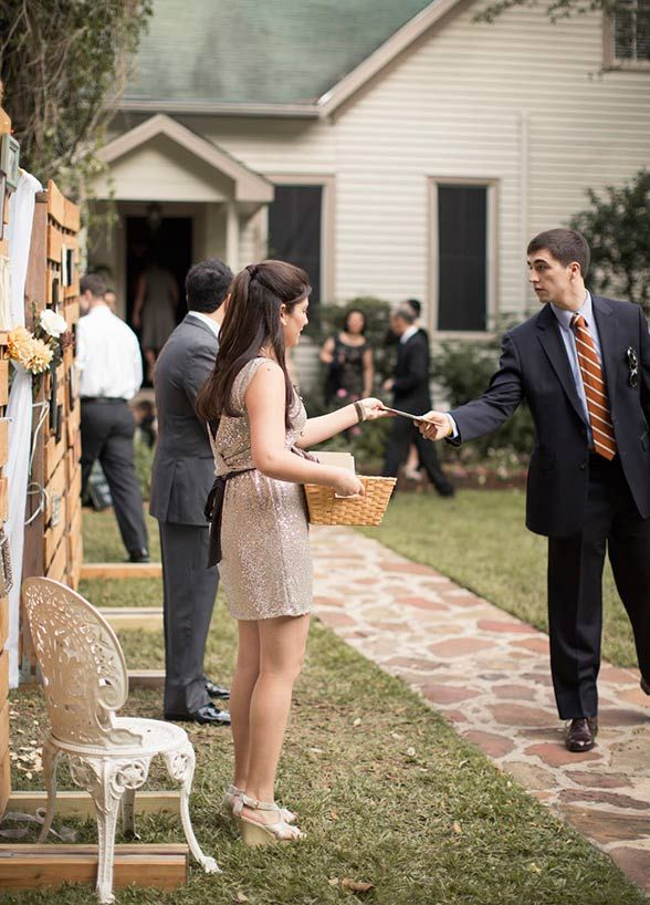 Ask Her To Be An Usher As far as duties go, this one is crucial. Ask a friend to greet your guests at the reception, show them to the escort cards and where to place their gifts. This important responsibility makes her just as visible as your bridesmaids and offers her the opportunity to meet more of your guests. Photo courtesy of Mustard Seed Photography