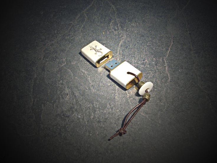 Memory USB stick   Materials: bone, brass, mother of pearl, leather cord, laser engraving, 8GB