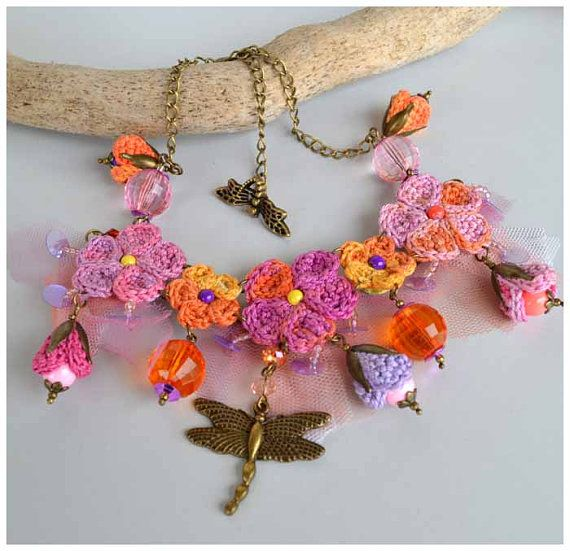 This colorful boho necklace is a piece of wearable art thats guaranteed not to go unnoticed! Ooak crochet flowers(I use my own patterns) in good