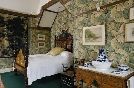 """Wightwick Manor: The Acanthus Room at Wightwick Manor, Wolverhampton, West Midlands. The William Morris """"Acanthus"""" wallpaper is original and the tapestry panel is 17th century Flemish. The bed is 19th century Italian incorporating marquetry and ivory panels including Adam and Eve. #William_Morris #Morris_and_Co #Wightwick_Manor"""