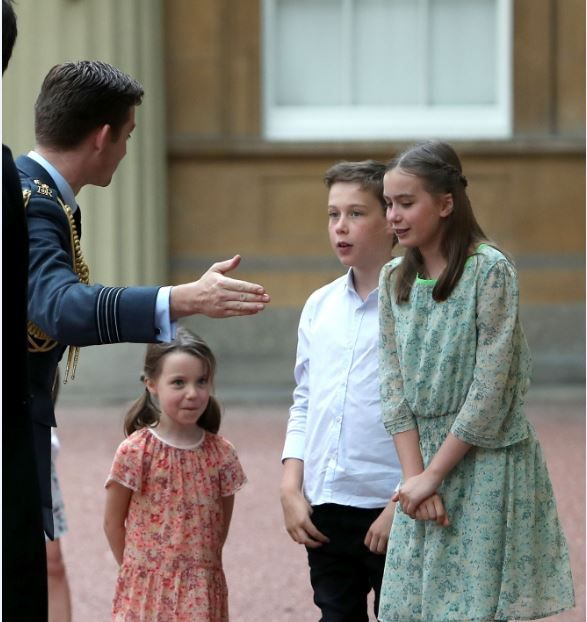 Nancy Gwen, Arthur Elwen and Florence Rose Endellion accompanied their dad to the palace (Picture: PA)