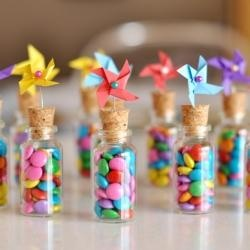 substitute windmills with wedding decor, add bride and grooms name to jar. GREAT IDEA
