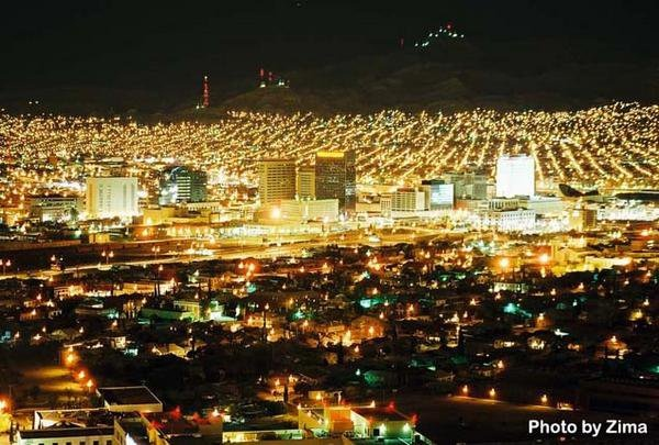 El Paso at night with the lights of Juarez, Mexico in the ...