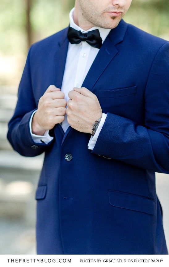 Groom's Blue Suit paired with a Black Bow-tie   Photography by Grace Studios Photography   Groom's suit by Eurosuit
