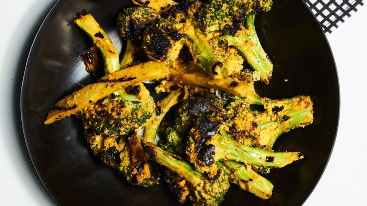 This is not your average side dish: The broccoli is slathered in a spiced yogurt sauce, then grilled for even more flavor.