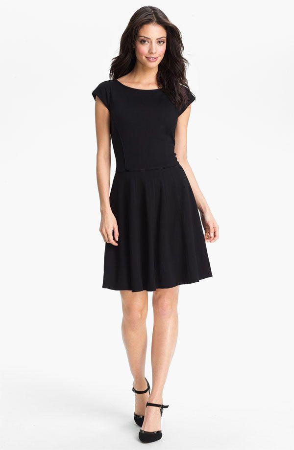 Orange dress black fascinator for funerals