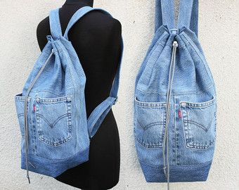 Items similar to denim backpack upcycled blue jeans drawstring bucket bag vintage boho hipster denim bag 80s 90s cinched top backpack recycled repurposed on Etsy
