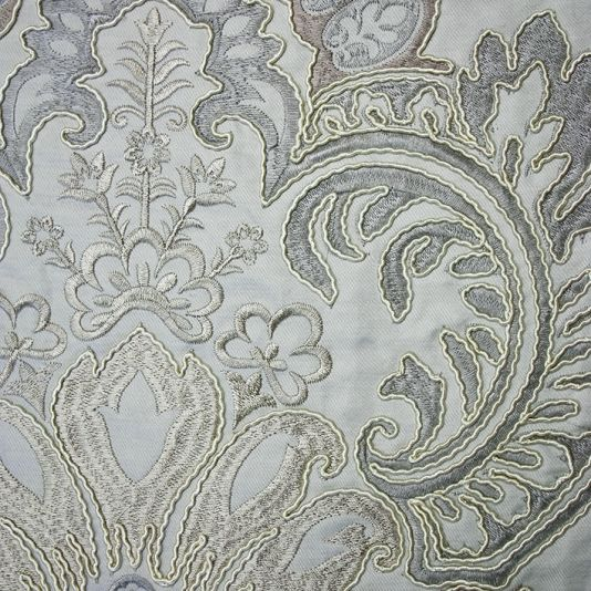 Waterford Damask Fabric An elegant damask fabric with ornate cushion embroidery creating a three dimensional effect in pale rose, bronze and...
