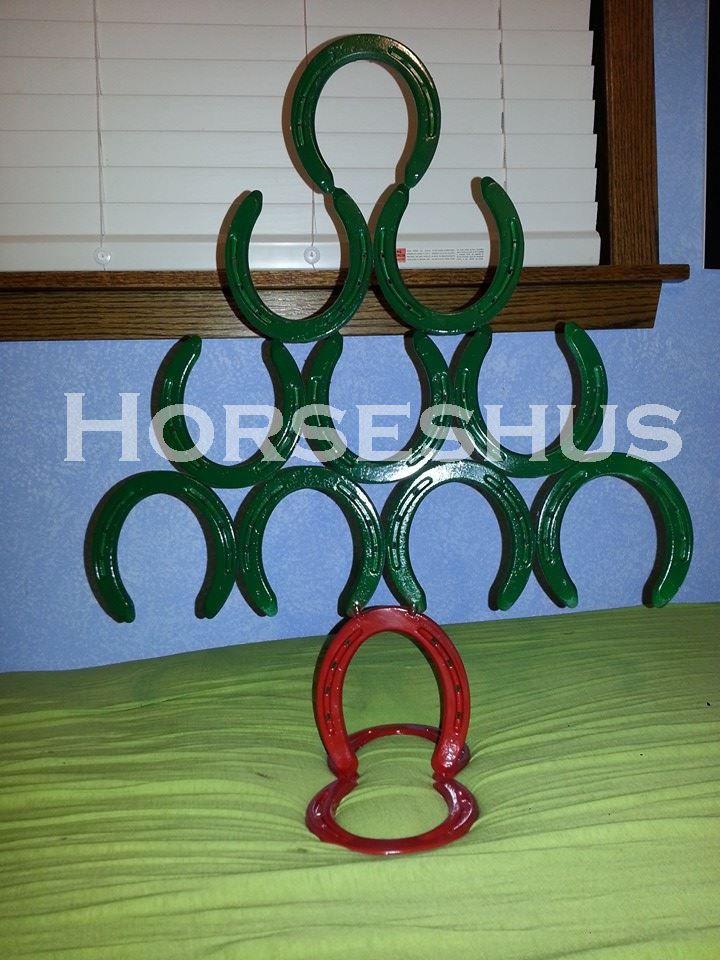 Horseshoe christmas tree made by horseshus https www for Christmas tree made out of horseshoes