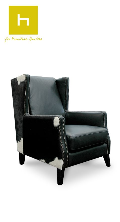 The Essex Lounge Chair from Hunter Furniture.   Beautiful design combines premium cow hide & black leather to create this impressive chair.  http://www.furniture.co.nz/our-products/all-products/lounge-chairs/essex-lounge-chair/  #furniturehunters