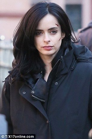 On the case: The pretty dark-haired actress was dressed in her character's trademark rippe...