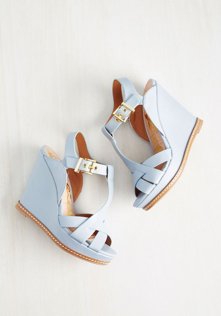 The world is your stage when you set out wearing these ash blue wedges, and they always win a ton of accolades! Boosted with large gold buckles, interwoven toe straps, and white-stitched soles, these flirty peep toes are like the first-place prize of fashion. Seize that spotlight, gal!