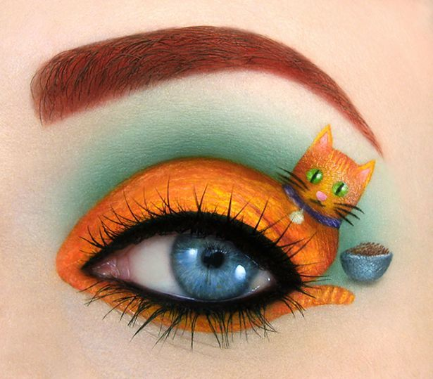 Paws for thought: For this scene, Tal used orange paint to create the cat's body on her eyelid