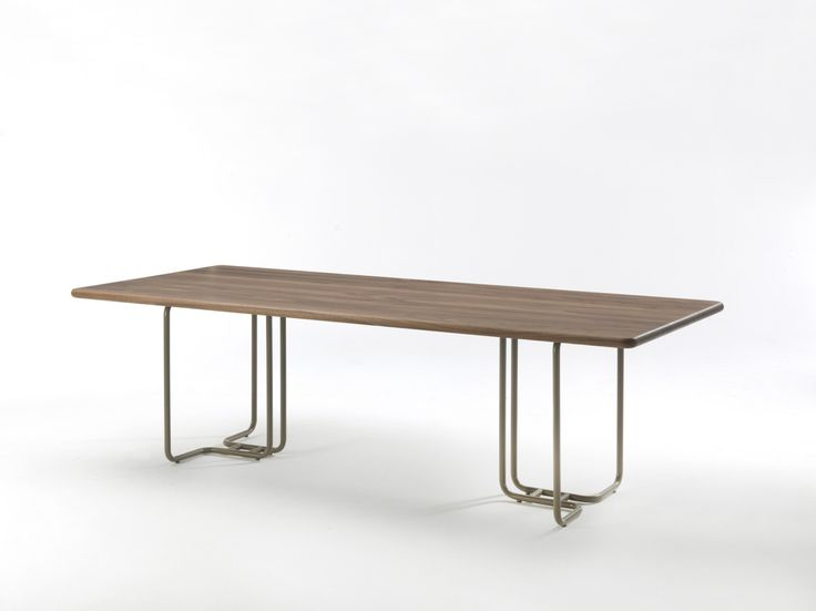 Tubular Table : This table has been designed to compliment the Tubular Shelves with a solid walnut top and a lacquered steel or brass frame option. The positioning of the tubular frame base allows for plenty of legroom when sitting at each end. The rolled edge and beveled corners of the tabletop compliment the tubular frame.