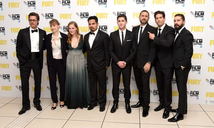 """Brad Pitt, Anamaria Marinca, Alicia von Rittberg, Michael Pena, Logan Lerman, director David Ayer, Jon Bernthal and Shia LeBeouf attend the closing night European Premiere gala red carpet arrivals for """"Fury"""" during the 58th BFI London Film Festival at Odeon Leicester Square on October 19, 2014 in London, England."""