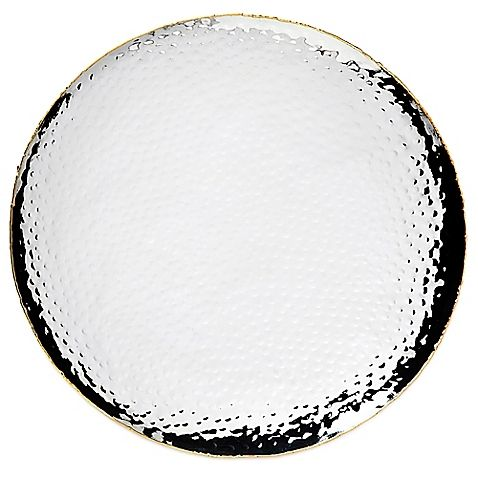 Brighten your table and your décor with the sophisticated style of this Artisan Loft Hammered 14-Inch Round Tray from Godinger. Beautifully crafted in mirror-finish stainless steel, these chic pieces feature an elegant gold border.