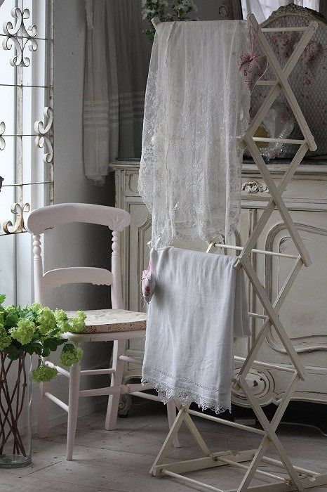 use my old drying rack to display vintage linens for GC sale