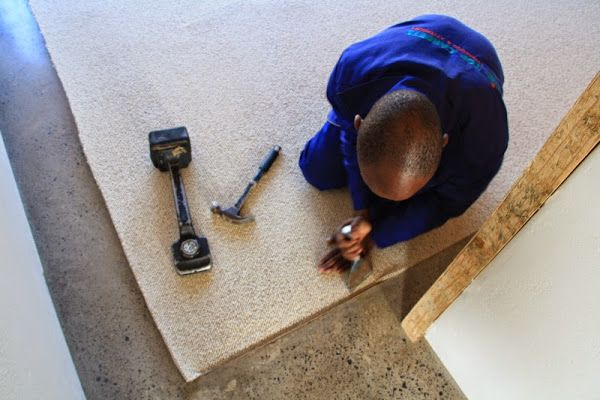 Carpet installation during the construction of a designer house