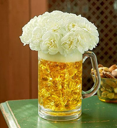 """""""Masculine Floral Arrangement"""" I'm writing to you from Chicago, where I attended a wedding last night. The tables on the women's side were decorated with pink flower arrangements, but there were none to be found for the men. I'm certain that men appreciate flowers, and I know we can do better.... Men??? I love beer. Perfect for me."""