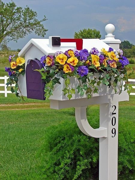 Mail Boxes with flowers. Too cute! What do you do in the winters time?
