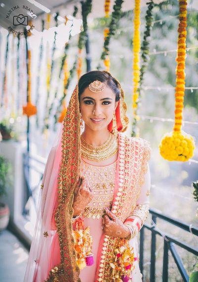 maang tikka , soft pink sharara , gota patti dupatta , pink and coral sharara , hanging pom pom kaleere , sikh bride , bridal portraits ,