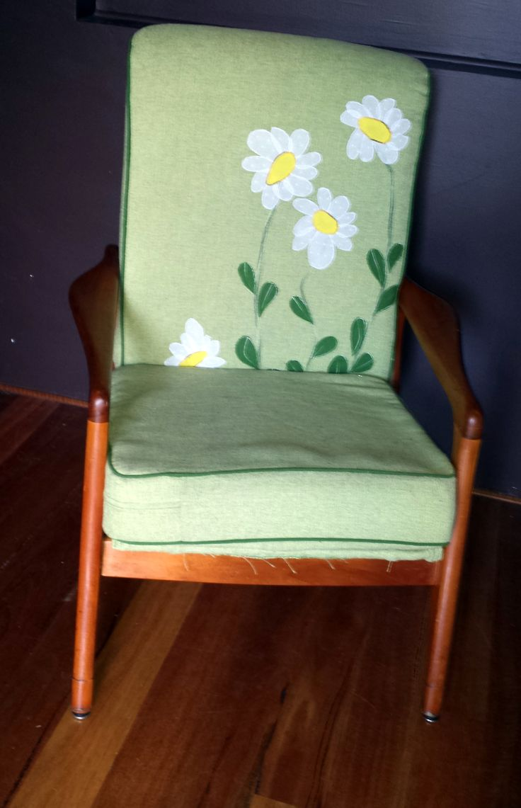 Fred Lowen chair upholstered in green with flower applique...