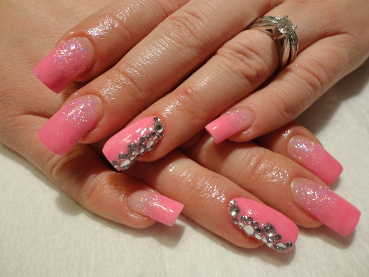 Pink nails with large stones.Beautiful!! also nice valentine nails :)