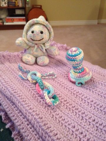Baby blanket with teething ring, rattle and doll