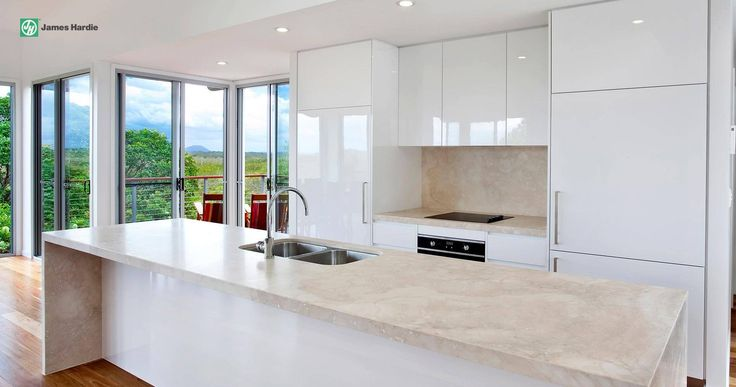 This home features open plan living, check out the lovely kitchen area #jameshardie #interior #kitchen #coastal #australia #linea #weatherboard #contemporary