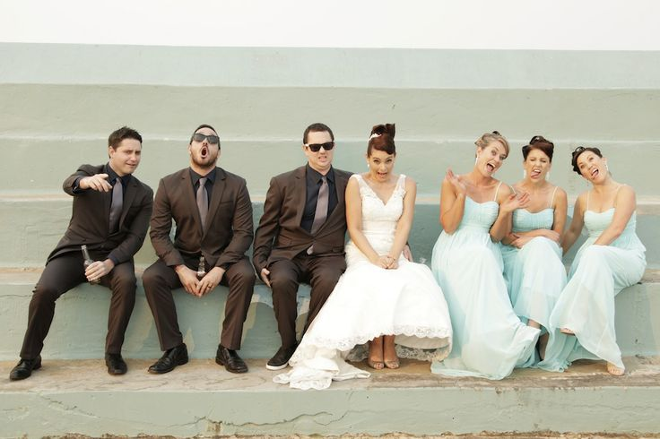 Funny faces are so much more fun than a forced smile, love the groomsmen on the end rockin this shot and how cute is the bride!