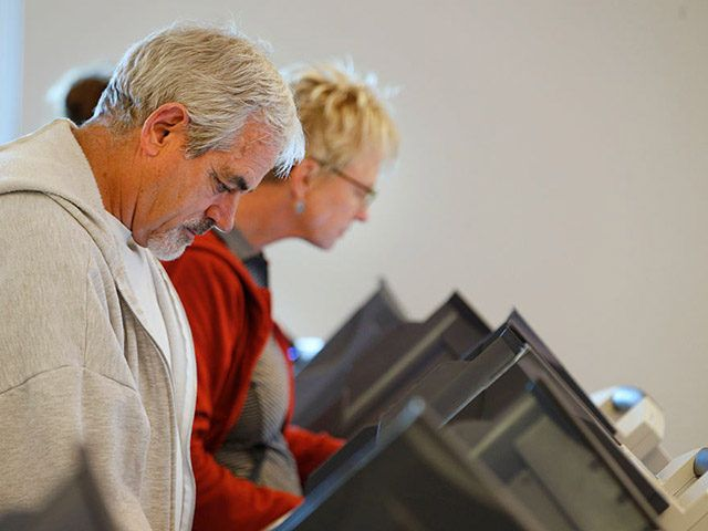 PROVO, UT - OCTOBER 25: People cast their ballots on electronic voting machines on the first day of early voting at the Provo Recreation Center, on October 25, 2016 in Provo, Utah. Early voting in the 2016 presidential election begins October 25 for Utah residents and is open until November 4. (Photo by George Frey/Getty Images)