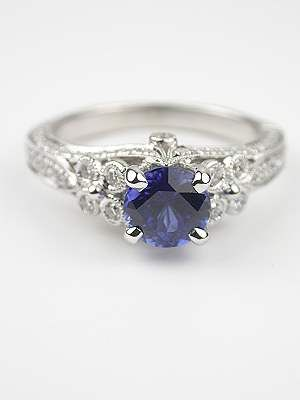 I like the cut of the sapphire and the band put the prongs are overwhelming