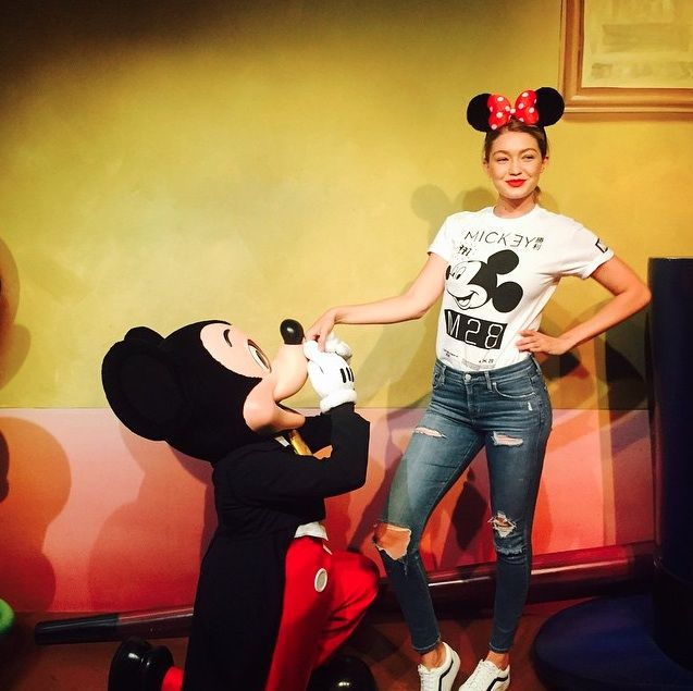 Stars, they're just like us. They go to Disneyland, they have to take a picture with Mickey Mouse, and of course, they wear their best Disney style while they are at it.