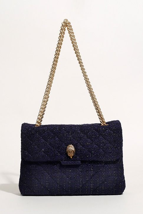 Navy Shoulder Bag. A refined, feminine option for your handbag rotation, Tweed Kensington Bag by Kurt Geiger London arrives in a colourful weave punctuated by luxe gold-tone hardware and a chain shoulder strap. Just the right size for those everyday essentials. Bag Dimensions: H: 21cm x W: 31cm x D: 10cm.