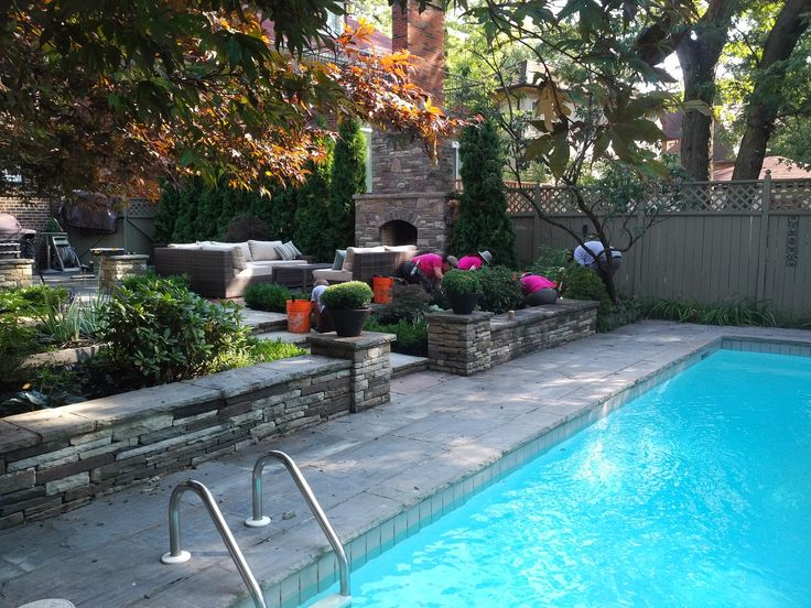This next space is classically LP, with a new outdoor fireplace, low stone walling and columns, and a flagstone pool surround.