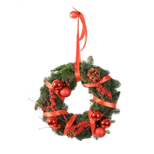 Corona de Navidad de pino decorada en rojo de 40cm de diametro. 60€