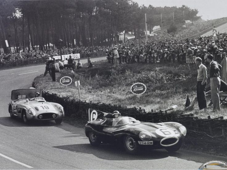 Mike Hawthorn, winner of the 1955 Le Mans race, leading the Fangio/Moss Mercedes-Benz 300 SLR, in his Jaguar D-type