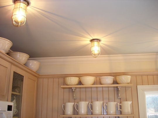 Nautical style lights in the kitchen-we have lights like these that Josh sandblasted, just need to install them someday!