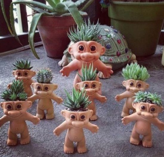 Troll Doll Planters Cut off the tops of the doll's heads to make these creepy, yet kind of cute planters.