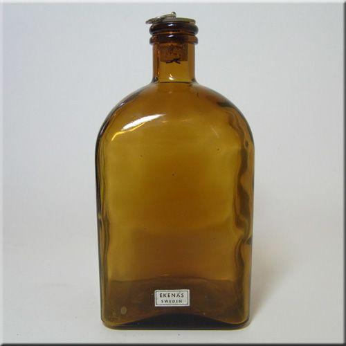 Ekenas Glasbruk Swedish labelled amber glass bottle/decanter.