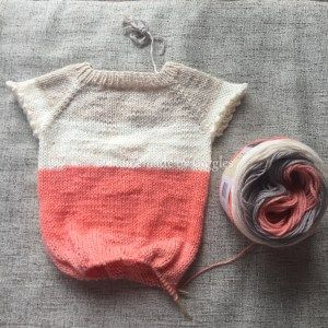 Caron Cake Kid's Knit Sweater Dress – Homemade by Giggles.  Link to free pattern and list of modifications to make this cute spring sweater dress for a little girl using Caron Cakes by Yarnspirations.