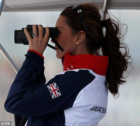 Kate used binoculars to get a closer look at the sailors out on the water, she wore her signature Givenchy sunglasses and had her hair scraped back