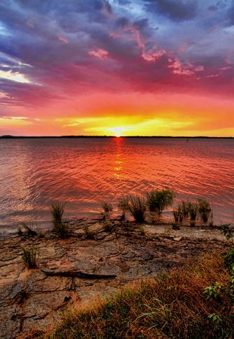 The wide horizon and brilliant reflections off the water make Oklahoma sunsets at Lake Eufaula a truly spectacular sight.