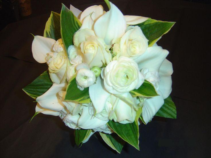 Hosta leaves, white ranunculas & calla lilys posy
