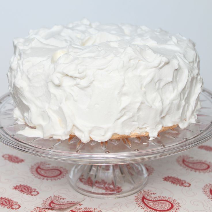 "Whipped Cream Frosting - ""Made with powdered sugar, this whipped cream frosting seems to be more stable than the whipped cream that I normally make but it is still light and fluffy.  Though it is plenty rich, it is lighter and less sweet than buttercream frosting, making it a perfect option for angel food cake and other light summer desserts."""