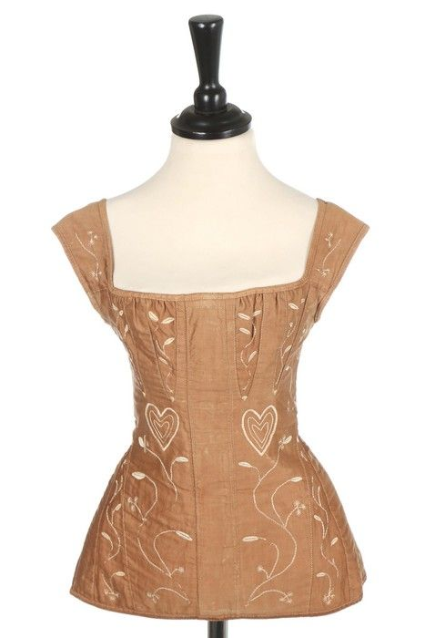 A pair of embroidered stays, American, circa 1825, of brown satinised cotton embroidered in ivory silks with hearts and foliate trails, broad centre-gusset for the insertion of a busk, single bone to rear closure, bust approx 71cm, 28in - See more at: http://kerrytaylorauctions.com/archive-list/?id=88&sts=archive&paging=1#sthash.uMXOwfjB.dpuf Kerry Taylor Auctions